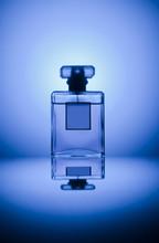 Perfume Bottle On Blue Background
