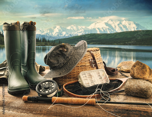Foto op Plexiglas Vissen Fly fishing equipment on deck with view of a lake and mountains