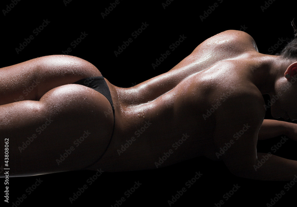 Fototapeta Sexy woman body, wet skin, black background