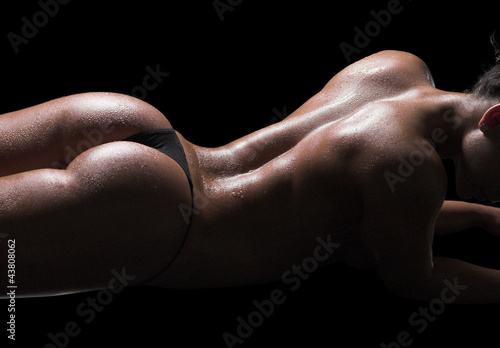 Sexy woman body, wet skin, black background