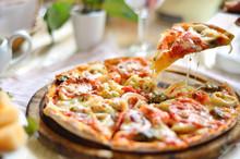 Original Italian Seafood Pizza Sliced On Wood Dish