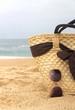 Seacoast, straw beach bag and sunglasses .