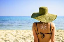 Woman On Beach With Sun Symbol...