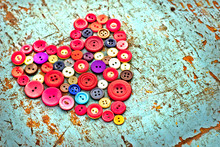 Red Heart Background On Vintage Old Surfase.Old Colorful Buttons
