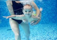 Little Boy Learning To Swim In...