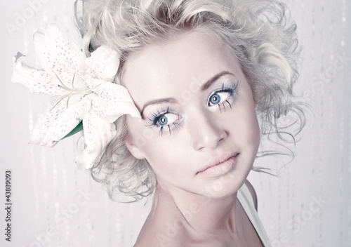 a4e45dd1aca8 Beautiful young female portrait with original make up and flower ...
