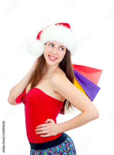 Keuken foto achterwand pretty girl in christmass hat with colorful bags