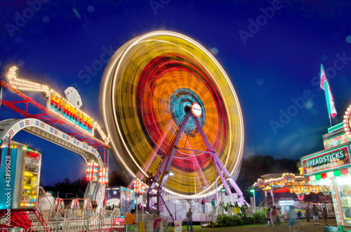 Poster Amusementspark Twilight over the fairground