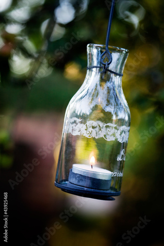 Photo  Lantern hanging from appletree