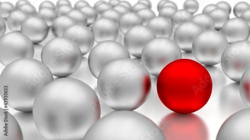 czerwona-kula-na-tle-chromowanych-bialych-kul
