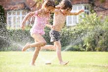 Two Children Running Through G...