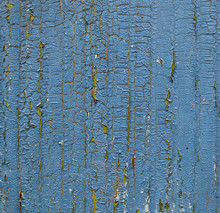 Cracked Paint On A Wooden Surface. Grunge Style Background.