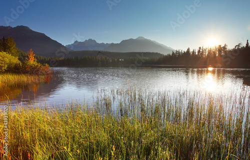 Foto op Canvas Bergen Sunset on mountain lake - Strbske pleso in Slovakia.