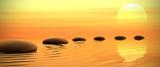 Fototapeta Kamienie - Zen path of stones on sunset in widescreen