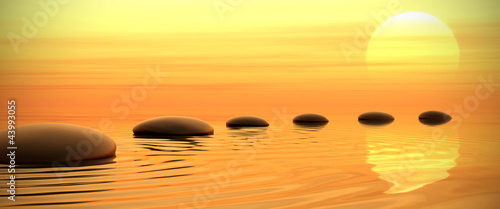 La pose en embrasure Zen Zen path of stones on sunset in widescreen