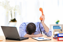 Exhausted Businessman Holding ...
