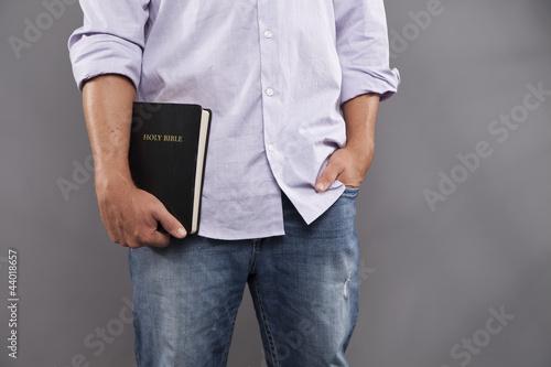 Fotografie, Obraz  Man Casually Holds Bible