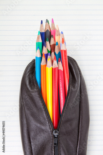 Fotografía Leather pencil case and pencils on paper in the lineup.