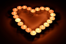 Burning Candles In The Form Of Heart