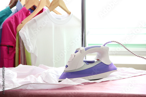 Fotografie, Obraz  Electric iron and shirt, on cloth background