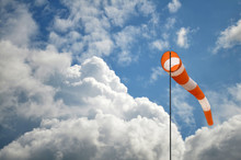 Windsock Against Blue Sky And Clouds