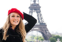 A Girl In A Red Hat In Paris