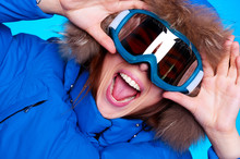 Woman In Ski Glasses And Winter Coat