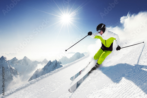 Garden Poster Winter sports Skier in mountains, prepared piste and sunny day