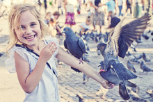 Smiling Girl With Pigeons On T...