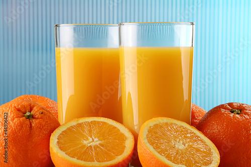 Fototapeta Glasses of orange juice and fruits obraz na płótnie