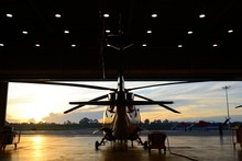 Silhouette Of Helicopter In Th...