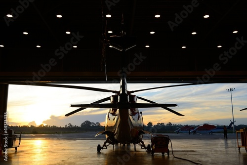Foto op Aluminium Helicopter silhouette of helicopter in the hangar