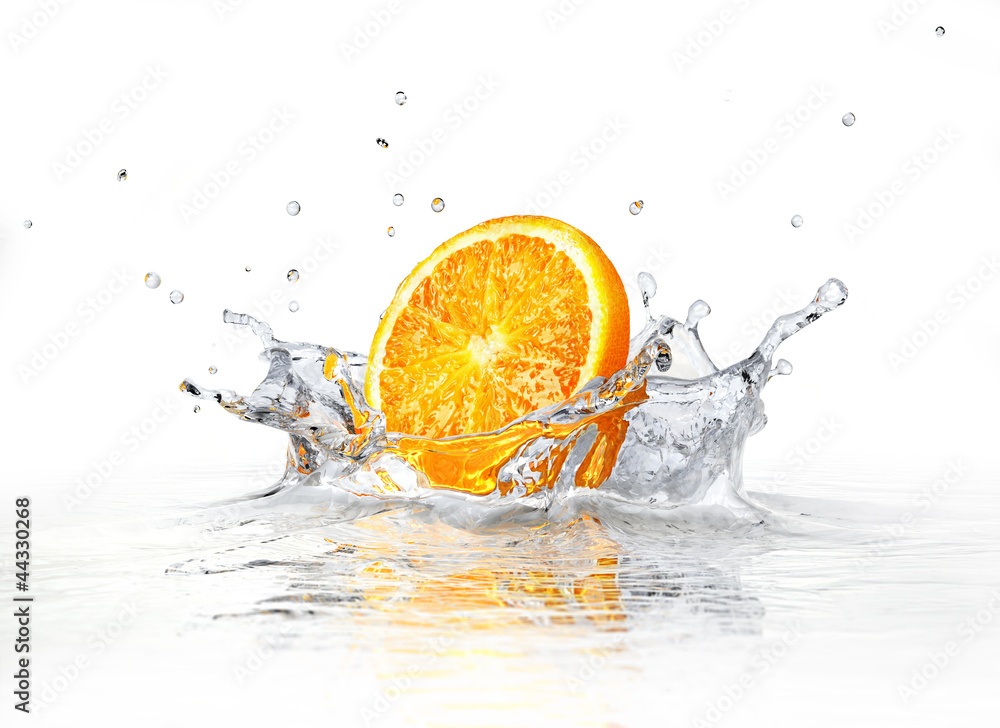 Fototapeta Orange slice falling and splashing into clear water.
