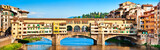 Panoramic view of Ponte Vecchio at sunset in Florence, Italy