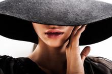 Girl In Black Hat Touching Fac...