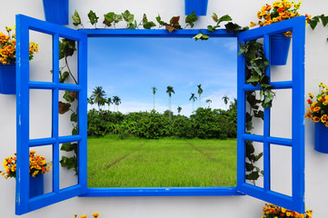 Fototapeta Blue Window Flame with green field and blue sky
