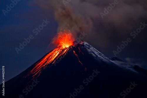 Poster Volcano Tungurahua Volcano eruption with blue skies and lava
