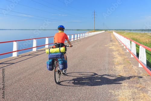 Canvas Prints Cycling Cyclist on a causeway, road between Saaremaa and Muhu.