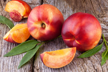 Nectarines  On Wood Background