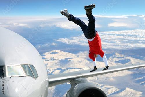 Fényképezés Extreme sport on on the plane wing