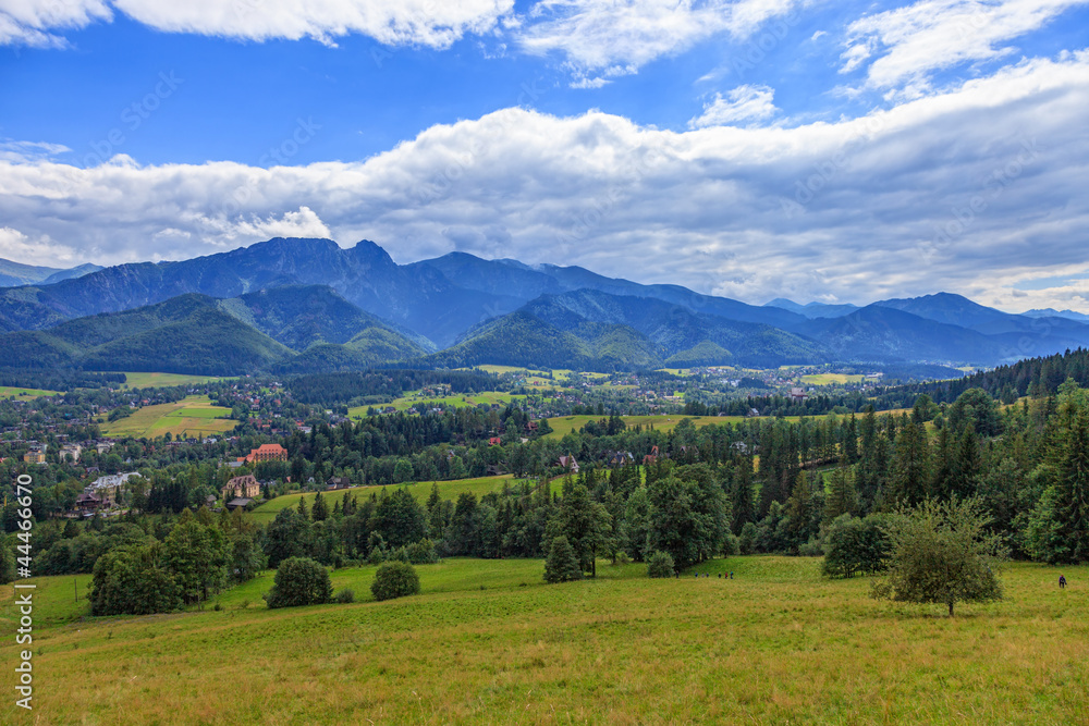 A view of The Tatra Mountains and village in summer, Poland.