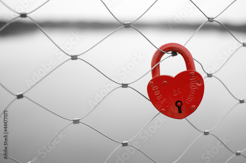 Acrylic Prints Red, black, white Love padlock on a bridge fence. Russian proverb on it.