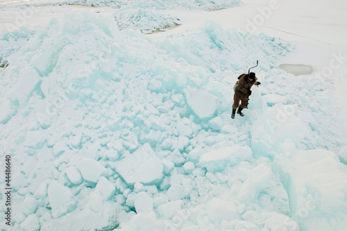 Fotografie, Obraz  Winter fisherman on ice rock.