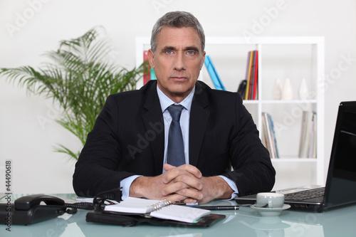 Photo  An austere businessman