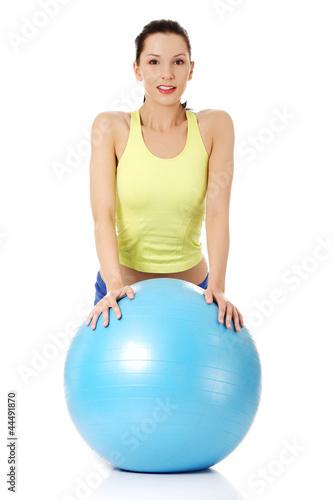 Plakat Kobieta z piłką fitness