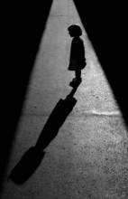 Silhuete Of A Little Girl Talking To Her Shadow