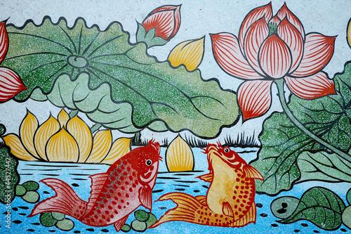 ryby-bogactwa-i-lotos-malarstwo-na-kamiennej-scianie