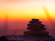 Stack of Five Flat Rocks on the Beach at Sunset