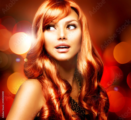 Beautiful Girl With Shiny Red Long Hair over Blinking Background