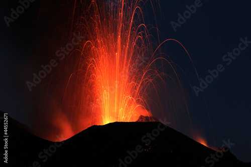Fototapeta  Fire at night. Volcano erupting